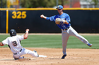Brandon Trinkwon #16 of the UC Santa Barbara Gauchos completes a double play during a game against the Cal State Northridge Matadors at Matador Field on May 11, 2013 in Northridge, California. UC Santa Barbara defeated Cal State Northridge, 6-2. (Larry Goren/Four Seam Images)