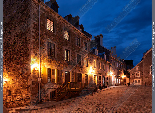 Illuminated corner of the Royal Square in Old Quebec City with its beautiful historic architecture and deep blue sky at night. Quebec, Canada. Place Royale, Ville de Québec.