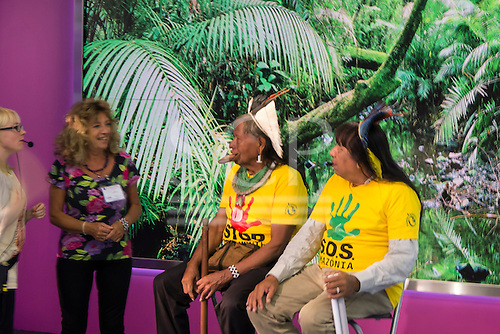 09 June 2014. Kayapo Chiefs Raoni Metuktire and Megaron Txucarramae during their visit to London. Interview with Paul Mason for Channel 4 News. The chiefs sit in front of a rainforest backdrop talking to Sue Cunningham of Tribes Alive in the studio before the interview