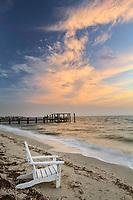 Chair on beach at sunrise, Boca Grande, Florida