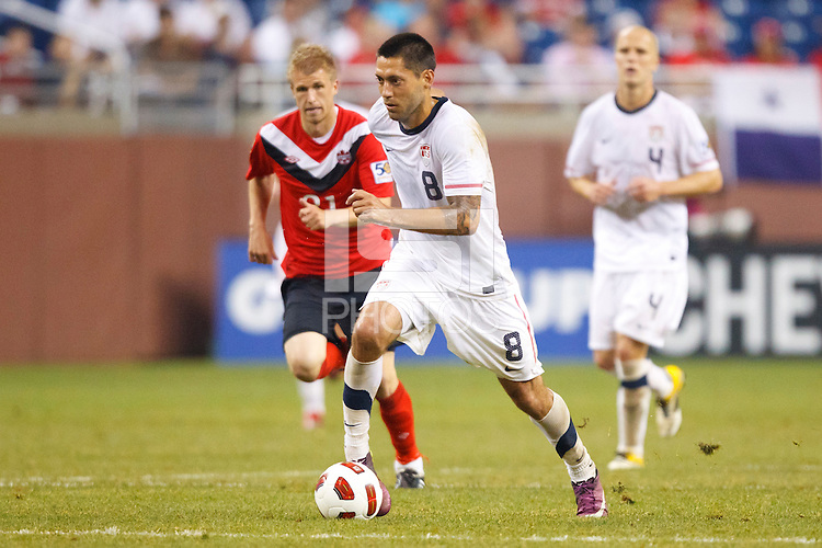 7 June 2011: Canada midfielder Jonathan Beaulieu-Bourgault (21) and USA Men's National Team forward Clint Dempsey (8) during the CONCACAF soccer match between USA and Canada at Ford Field Detroit, Michigan. USA won 2-0.