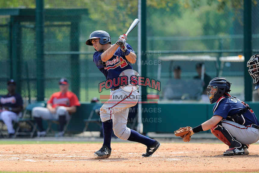Second baseman Jose Peraza (57) of the Atlanta Braves farm system in a Minor League Spring Training intrasquad game on Wednesday, March 18, 2015, at the ESPN Wide World of Sports Complex in Lake Buena Vista, Florida. The catcher is Chris O'Dowd. (Tom Priddy/Four Seam Images)