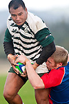 Bruce John tries to dislodge the ball as well as tackle Aukustino Tapu. Counties Manukau Premier Club Rugby game between Ardmore Marist and Manurewa, played at Bruce Pulman Park, Papakura on Saturday July 18th 2009..Ardmore Marist won the game 32 - 5 after leading 10 - 5 at halftime.