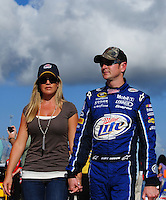Nov. 14, 2008; Homestead, FL, USA; NASCAR Sprint Cup Series driver Kurt Busch (right) with wide Eva Busch during qualifying for the Ford 400 at Homestead Miami Speedway. Mandatory Credit: Mark J. Rebilas-