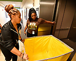 Britney Christian (right) holds the elevator door for incoming freshman Hailey Harris at Harris-Stowe State University in St. Louis on Wednesday August 15, 2018. Harris was using the carts provided by the school to move items into her dorm room.    Photo by Tim Vizer