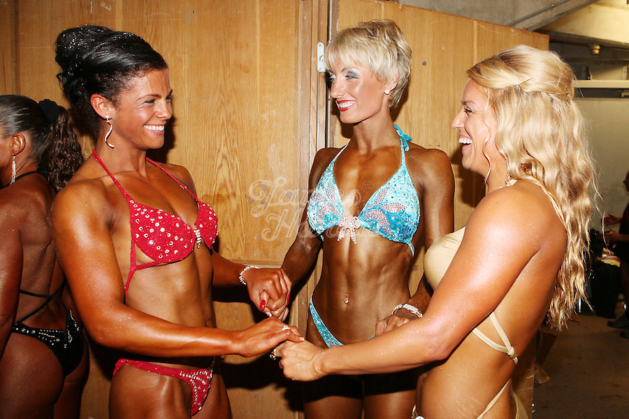 23/10/2010. Irish female physique and figure fitness national championships. Laura Newton from Galway, Inga Beimore from Dublin and Leona Spellman are pictured backstage during the female figure fitness category as part of the 2010 RIBBF national bodybuilding championships at the University of Limerick Concert Hall, Limerick, Ireland. Picture James Horan.