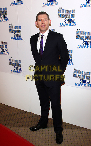 LEE EVANS .Attending the South Bank Show Awards at the Dorchester Hotel, Park Lane, London, UK, January 26th 2010..arrivals full length suit  purple tie black suit white shirt .CAP/ROS.©Steve Ross/Capital Pictures.