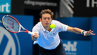 Nicolas Mahut of France hits a forehand to Juan Martin del Potro of Argentina during their men's singles match at the Sydney International tennis tournament in Sydney, Australia, Wednesday, Jan. 8, 2014.  IMAGE RESTRICTED TO EDITORIAL USE ONLY. Photo by Daniel Munoz/VIEWpress
