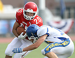 SIOUX FALLS, SD - SEPTEMBER 7:  Caden Quintanilla #25 from Lincoln is brought down by Tanner Schulte #16 from O'Gorman in the first quarter of their game at the 2013 Presidents Bowl at Howard Wood Field. (Photo by Dave Eggen/Inertia)