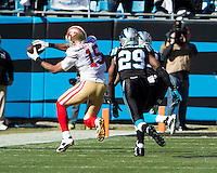 The Carolina Panthers played the San Francisco 49ers at Bank of America Stadium in Charlotte, NC in the NFC divisional playoffs on January 12, 2014.  The 49ers won 23-10.  San Francisco 49ers wide receiver Michael Crabtree (15), Carolina Panthers cornerback Drayton Florence (29)
