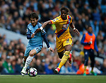 David Silva of Manchester City in action with Wilfried Zaha of Crystal Palace during the English Premier League match at the Etihad Stadium, Manchester. Picture date: May 6th 2017. Pic credit should read: Simon Bellis/Sportimage