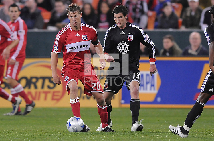 Chicago Fire forward Brian Mcbride (20) shields the ball  while covered from behind  by DC United midfielder Chris Pontius (13), Chicago Fire tied  DC United 1-1 at  RFK Stadium, Saturday March 28, 2009.