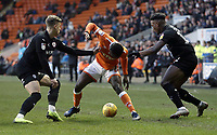 Blackpool's Marc Bola vies for possession with Barnsley's  Brad Potts (left) and Dimitri Cavare<br /> <br /> Photographer Rich Linley/CameraSport<br /> <br /> The EFL Sky Bet League One - Blackpool v Barnsley - Saturday 22nd December 2018 - Bloomfield Road - Blackpool<br /> <br /> World Copyright &copy; 2018 CameraSport. All rights reserved. 43 Linden Ave. Countesthorpe. Leicester. England. LE8 5PG - Tel: +44 (0) 116 277 4147 - admin@camerasport.com - www.camerasport.com