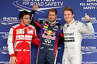 SAO PAULO, SP, 23.11.2013 - F1 - TREINOS LIVRES -  O piloto alemao Sebastian Vettel © da Red Bull comemora pole position ao lado de Fernando Alonso (E) e Nico Rosberg (D) apos o treino classificatorio deste sábado (23) para o Grande Prêmio do Brasil de Fórmula 1, no autódromo de Interlagos, na zona sul de São Paulo. O treino de classificação para a corrida, que ocorre amanhã, começa hoje a partir das 14h. (Foto: Lukas Gorys / Brazil Photo Press).