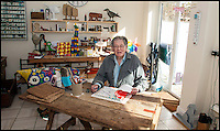BNPS.co.uk (01202 558833)<br /> Pic: ClaireBorley/BNPS<br /> <br /> ***Must Use Full Byline***<br /> <br /> Tom in his studio.  <br /> <br /> The original drawing designs for the Raleigh Chopper have come to light 45 years after the first ever iconic bicycle was made.<br /> <br /> The idea for the much-loved 1970s bike began as a quick doodle by inventor Tom Karen.<br /> <br /> The first scribbled sketches were just basic outlines but they clearly show its most famous features - large U-shaped handlebars and rear wheel and long leather seats.<br /> <br /> The rough sketches evolved into formal designs and Raleigh produced the first Mark I Choppers in 1969.<br /> <br /> They soon became the must-have children's item across Britain and more than 1.5 million of them were made until production ceased in 1979.<br /> <br /> The two pages of original drawings were retained by Mr Karen, now aged 87, and he took<br /> them with him when in 1999 he retired from Ogle Design, the consultancy firm used by Raleigh.<br /> <br /> Since then his sketch books have been left gathering dust in the garage of the grandfather's home in Cambridge. He has now dug them out after rediscovering them.<br /> <br /> Mr Karen said: &quot;The sketch books were just for me to do some rough doodles for me to pass on my ideas to the designers to work on and show to the client.