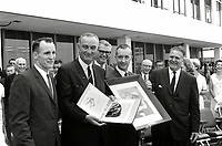 "Johnson Space Center , USA - June /14/1965 - File Photo - President Lyndon Johnson shows off photos of astronaut Edward H. White II during his historic ""space walk"" extravehicular activity (EVA) on the Gemini 4 flight. Major participants from left to right are: Robert Gilruth (background) Ed White, President Lyndon Johnson, Robert Seamans, Jim McDivitt and James Webb."