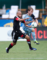 Seth Sinovic (15) of Sporting Kansas City fights for the ball with Kyle Porter (19) of D.C. United during a Major League Soccer match at RFK Stadium in Washington, DC.  D.C. United tied Sporting Kansas City, 1-1.
