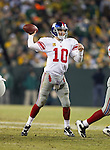 New York Giants quarterback Eli Manning (10) throws a pass during an NFL divisional playoff football game against the Green Bay Packers on January 15, 2012 in Green Bay, Wisconsin. The Giants won 37-20. (AP Photo/David Stluka)