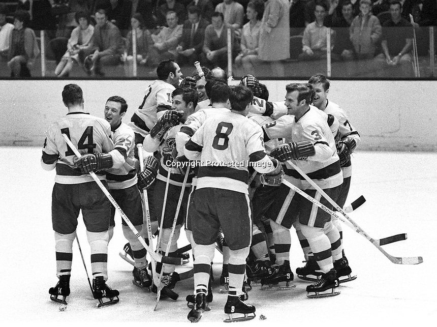 LA Kings celebrate play-off win against the Seals,.#8 Brian Smith, #3 Dave Amadio, Skip Krake, Billy Inglis, Jacques Lemieux, Bill White, Billy Inglis and Eddie Joyal.   (1969 photo by Ron Riesterer)