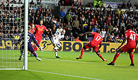 Pictured: Jonjo Shelvey of Swansea (3rd L) opens the score, Liverpool goalkeeper Simon Mignolet (L) fails to save the ball. Monday 16 September 2013<br /> Re: Barclay's Premier League, Swansea City FC v Liverpool at the Liberty Stadium, south Wales.