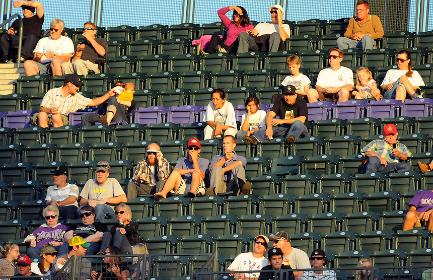 "24 AUGUST 2010: Baseball fans sit high above the field at Coors Field, near the ""Purple Row"" which is a row of purple seats signifying 5,280 feet of elevation during a regular season Major League Baseball game between the Colorado Rockies and the Atlanta Braves at Coors Field in Denver, Colorado. The Rockies beat the Brave 3-2.  *****For Editorial Use Only*****"