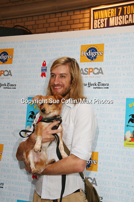 "HAIR cast - Bryce Ryness at Broadway Barks 11 - a ""Pawpular"" star-studded dog and cat adopt-a-thon on July 11, 2009 in Shubert Alley, New York City, NY. (Photo by Sue Coflin/Max Photos)"