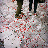 Red paint splattered on the pavement after a demonstration in Syntagma square during the financial crisis.