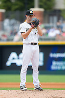 Charlotte Knights relief pitcher Scott Snodgress (47) looks to his catcher for the sign against the Pawtucket Red Sox at BB&T Ballpark on August 10, 2014 in Charlotte, North Carolina.  The Red Sox defeated the Knights  6-4.  (Brian Westerholt/Four Seam Images)