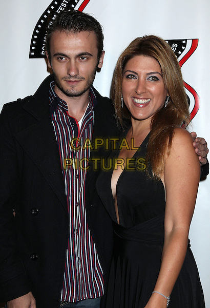 Arber Kucana &amp; Michelle Alexandria <br /> 13th annual Polish film festival at American Cinematheque's Egyptian Theatre, Hollywood, California, USA.<br /> 9th October 2012<br /> half length black suit jacket dress blue stripe shirt red stubble facial hair <br /> CAP/ADM/RE<br /> &copy;Russ Elliot/AdMedia/Capital Pictures