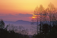 The sun rises over a misty valley off of Foorthills Parkway in Great Smoky Mountains National Park in Tennessee