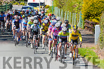 The cyclists in the Johnny Drumm cycle race pass Currow village on Sunday