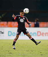 Andy Najar (14) of D.C. United heads the ball during the game at RFK Stadium in Washington, DC.  D.C. United defeated Chivas USA, 1-0.