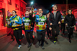 "People run on the 20th Korrika. Castejon (Basque Country). April 1, 2017. The ""Korrika"" is a relay course, with a wooden baton that passes from hand to hand without interruption, organised every two years in a bid to promote the basque language. The Korrika runs over 11 days and 10 nights, crossing many Basque villages and cities. This year was the 20th edition and run more than 2500 Kilometres. Some people consider it an honour to carry the baton with the symbol of the Basques, ""buying"" kilometres to support Basque language teaching. (Gari Garaialde / Bostok Photo)"