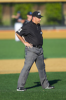 Umpire Darren Spagnardi works the bases during the ACC baseball game between the Duke Blue Devils and the Wake Forest Demon Deacons at Wake Forest Baseball Park on April 25, 2014 in Winston-Salem, North Carolina.  The Blue Devils defeated the Demon Deacons 5-2.  (Brian Westerholt/Four Seam Images)
