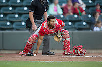 Potomac Nationals catcher Raudy Read (21) checks the runner at first base after blocking a pitch in the dirt during the game against the Winston-Salem Dash at BB&T Ballpark on May 13, 2016 in Winston-Salem, North Carolina.  The Dash defeated the Nationals 5-4 in 11 innings.  (Brian Westerholt/Four Seam Images)