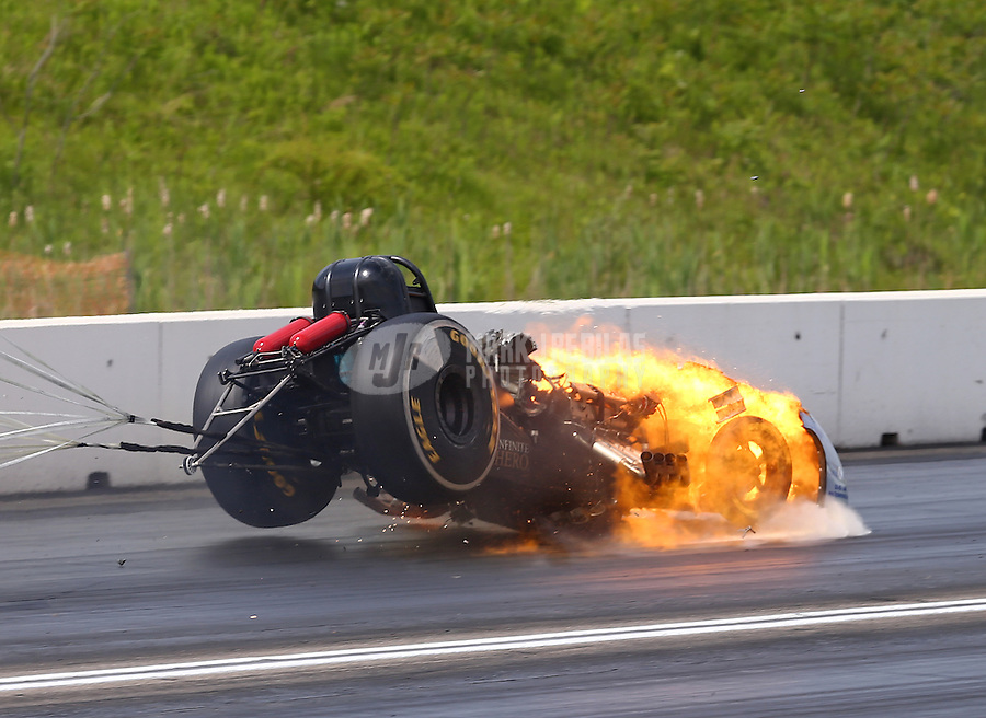 Jun 4, 2016; Epping , NH, USA; The car of NHRA funny car driver Jack Beckman on fire after an engine explosion during qualifying for the New England Nationals at New England Dragway. Beckman was uninjured. Mandatory Credit: Mark J. Rebilas-USA TODAY Sports