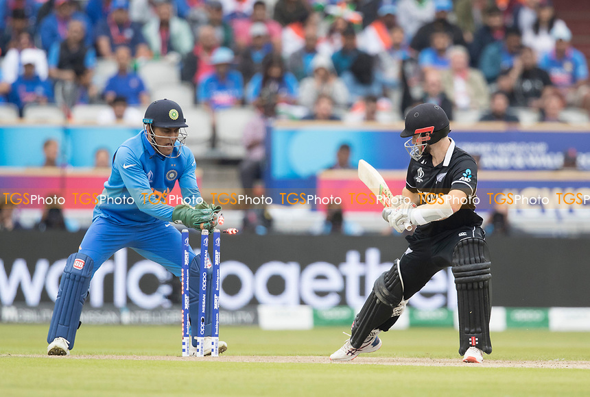 Kane Williamson (New Zealand) keeps his foot grounded as 'MS Dhoni (India) looks for a stumping during India vs New Zealand, ICC World Cup Semi-Final Cricket at Old Trafford on 9th July 2019