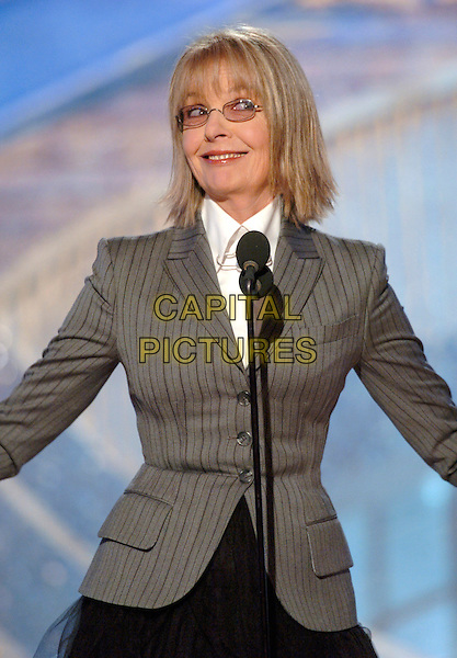DIANE KEATON.62nd Annual Golden Globe Awards, Beverly Hills, Los Angeles, California.January 16th, 2005.half length, stage, microphone, gray, grey jacket, glasses.www.capitalpictures.com.sales@capitalpictures.com.Supplied by Capital Pictures.