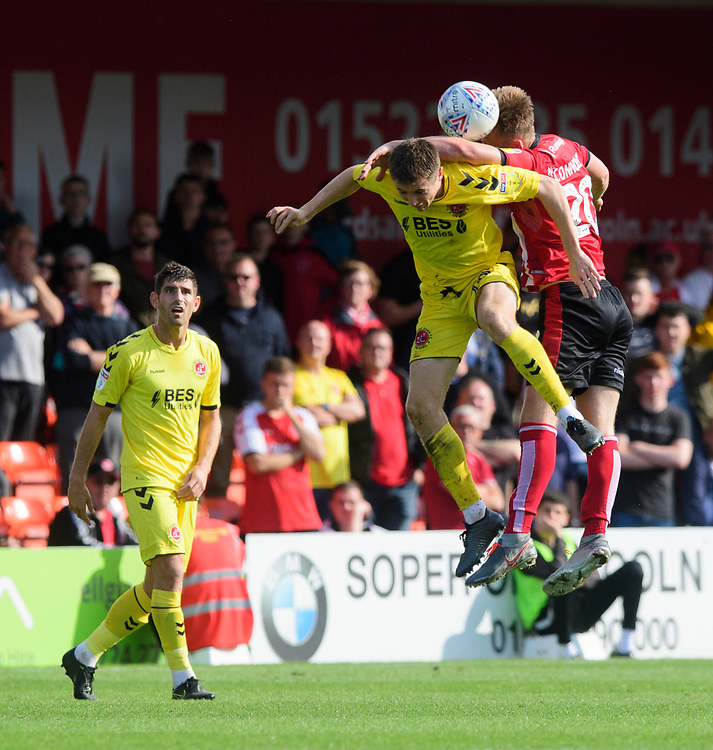 Fleetwood Town's Jordan Rossiter is fouled by Lincoln City's Callum Connolly<br /> <br /> Photographer Chris Vaughan/CameraSport<br /> <br /> The EFL Sky Bet League One - Lincoln City v Fleetwood Town - Saturday 31st August 2019 - Sincil Bank - Lincoln<br /> <br /> World Copyright © 2019 CameraSport. All rights reserved. 43 Linden Ave. Countesthorpe. Leicester. England. LE8 5PG - Tel: +44 (0) 116 277 4147 - admin@camerasport.com - www.camerasport.com