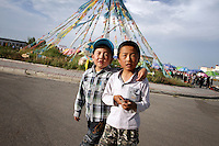 Two young friends in a town near Qinghai Lake. Qinghai Province. China. 2010
