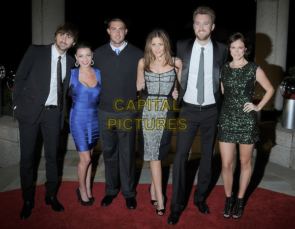 LADY ANTEBELLUM ( Charles Kelley,  Dave Haywood and Hillary Scott ) & GUESTS .At the 57th Annual BMI Country Awards held at BMI Music Row Headquarters, Nashville, Tennessee, USA, .10th November 2008..full length black suit tie grey gray blue green dress grey gray sparkly bandage open toe black shoes hand on hip .CAP/ADM/LF.©Laura Farr/AdMedia/Capital Pictures.