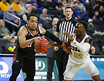 SIOUX FALLS, SD - MARCH 8: JT Gibson #0 of the Nebraska-Omaha Mavericks drives to the basket along the baseline against R.J. Fuqua #12 of the Oral Roberts Golden Eagles at the 2020 Summit League Basketball Championship in Sioux Falls, SD. (Photo by Richard Carlson/Inertia)