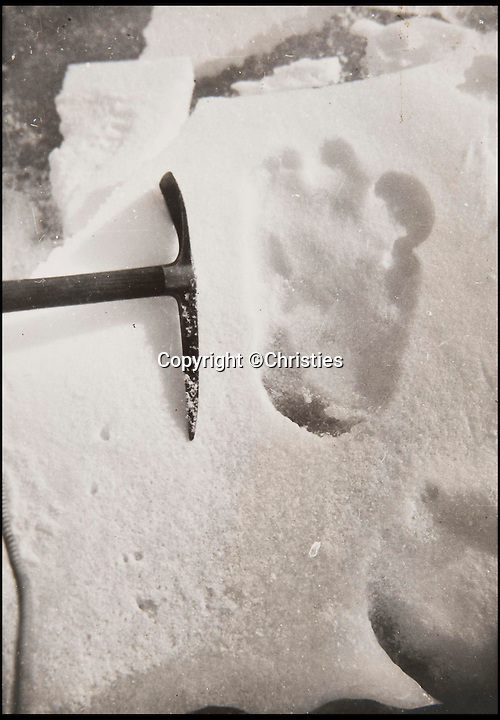 BNPS.co.uk (01202 558833)<br /> Pic: Christies/BNPS<br /> <br /> A picture showing the size of the footprint againt a pick axe.<br /> <br /> The first photographs showing what is believed to be the famous 'Yeti' have emerged for sale.<br /> <br /> British explorer Eric Earle Shipton took the historical pictures in 1951 when he was trekking at 19,000ft in the Himalayas.<br /> <br /> He spotted the mysterious 13-inch footprint in the snow and his iconic photograph caused a global stir, which has divided explorers and historians for decades.