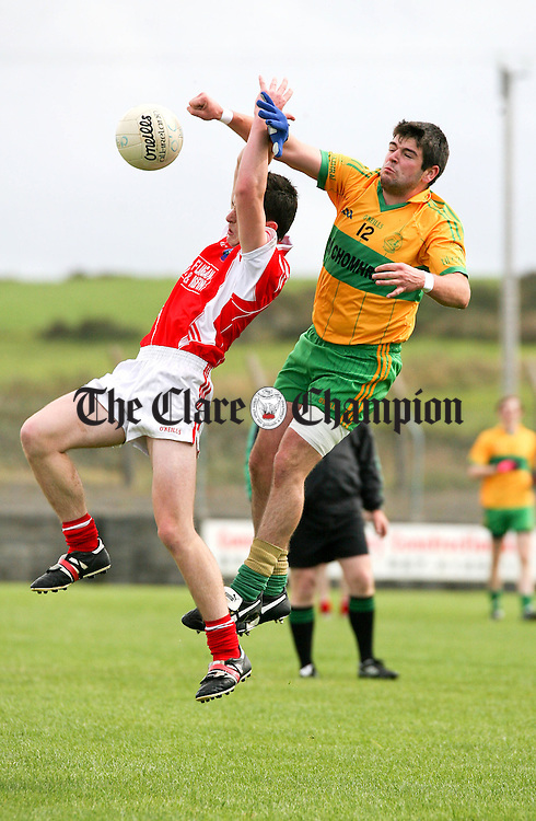 030911.Corofins (7) Manus Malone is beaten in the air by O'Currys Michael Foran during their Intermediate match at Quilty on Saturday.