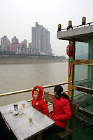 CHINA. Sichuan Province. Chongqing. Tourists on a boat on The Yangtze River which is at its lowest level in 150 years as a result of a country-wide drought. Chongqing is a city of over 3,000,000 people, famed for being the capital of China between 1938 and 1946 during World War II. It is situated on the banks of the Yangtze river, China's longest river and the third longest in the world. Originating in Tibet, the river flows for 3,964 miles (6,380km) through central China into the East China Sea at Shanghai.  2008.