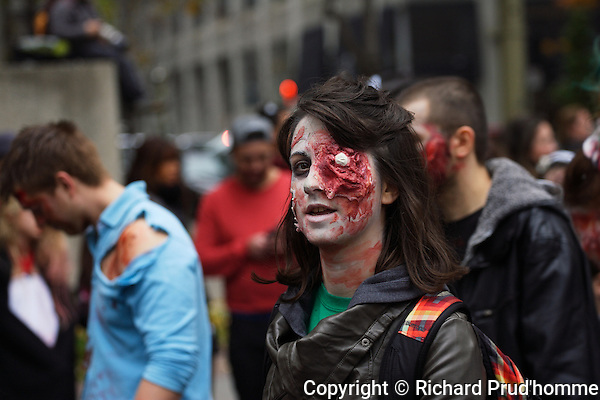 A female zombie with a disfigured eye in downtown Montreal