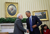 United States President Barack Obama shakes hands with Prime Minister Narendra Modi of India in the Oval Office of the White House September 30, 2014 in Washington, DC. The two leaders met to discuss the U.S.-India strategic partnership and mutual interest issues.  <br /> Credit: Alex Wong / Pool via CNP