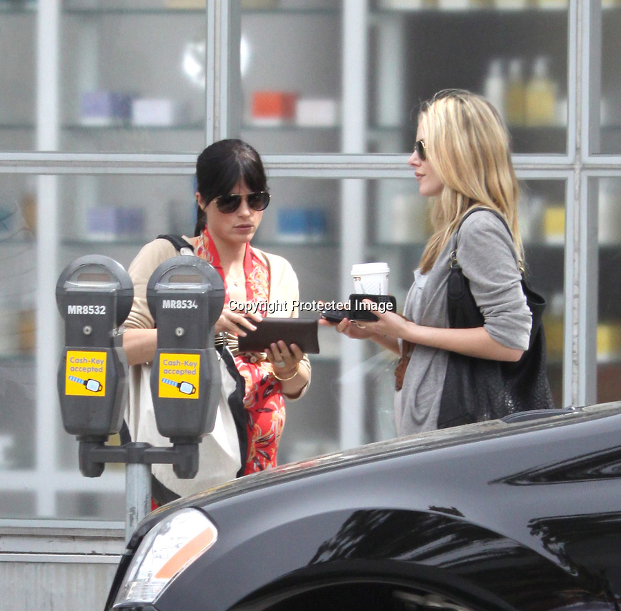 ...May 16th 2011...Selma Blair eating lunch with a pretty blonde friend at a restaurant called Le Pain Quotidien in west Hollywood carrying a big black & white purse handbag & showing off her pregnant baby bump rubbing her big belly in a lovely red rose flower feather dress & white SB sandals .Selma left the restaurant & forgot to pay because she had to put more money in the parking meter. The two girls walked back inside the restaurant to pick up the bill .& were laughing and smiling & joking around look at funny cell phone pics ....AbilityFilms@yahoo.com.805-427-3519.www.AbilityFilms.com.