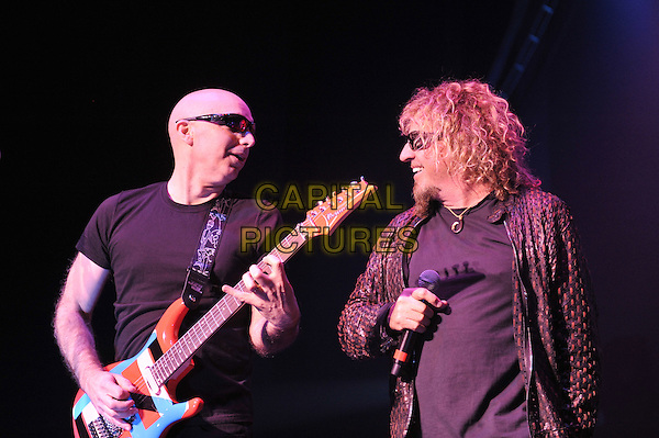 Joe Satriani and Sammy Hagar.Chickenfoot performing live in concert, Brixton Academy, London, England. 14th January 2012.on stage gig performance music half length black t-shirt sunglasses shades guitar suit profile   .CAP/MAR.© Martin Harris/Capital Pictures.