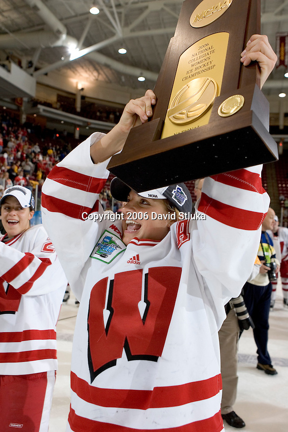 MINNEAPOLIS, MN - MARCH 26: Nikki Burish #14 of the Wisconsin Badgers women's hockey team displays the National Championship trophy after beating the Minnesota Golden Gophers at Mariucci Arena during the Women's Frozen Four Tournament final on March 26, 2006 in Minneapolis, Minnesota. The Badgers beat the Gophers 3-0. (Photo by David Stluka)